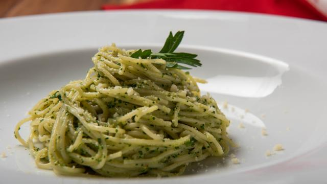 A close up view of pesto pasta at a high end restaurant