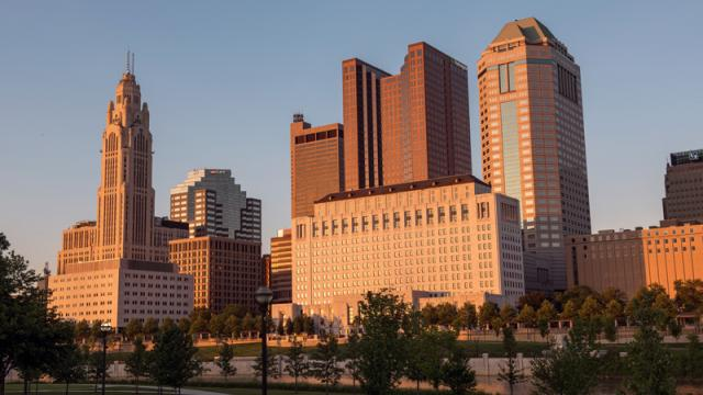 A view of the Columbus, Ohio skyline at dusk from the riverfront